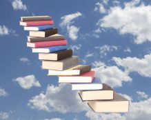 20984552 - a stair case of books floating on a cloudy sky background