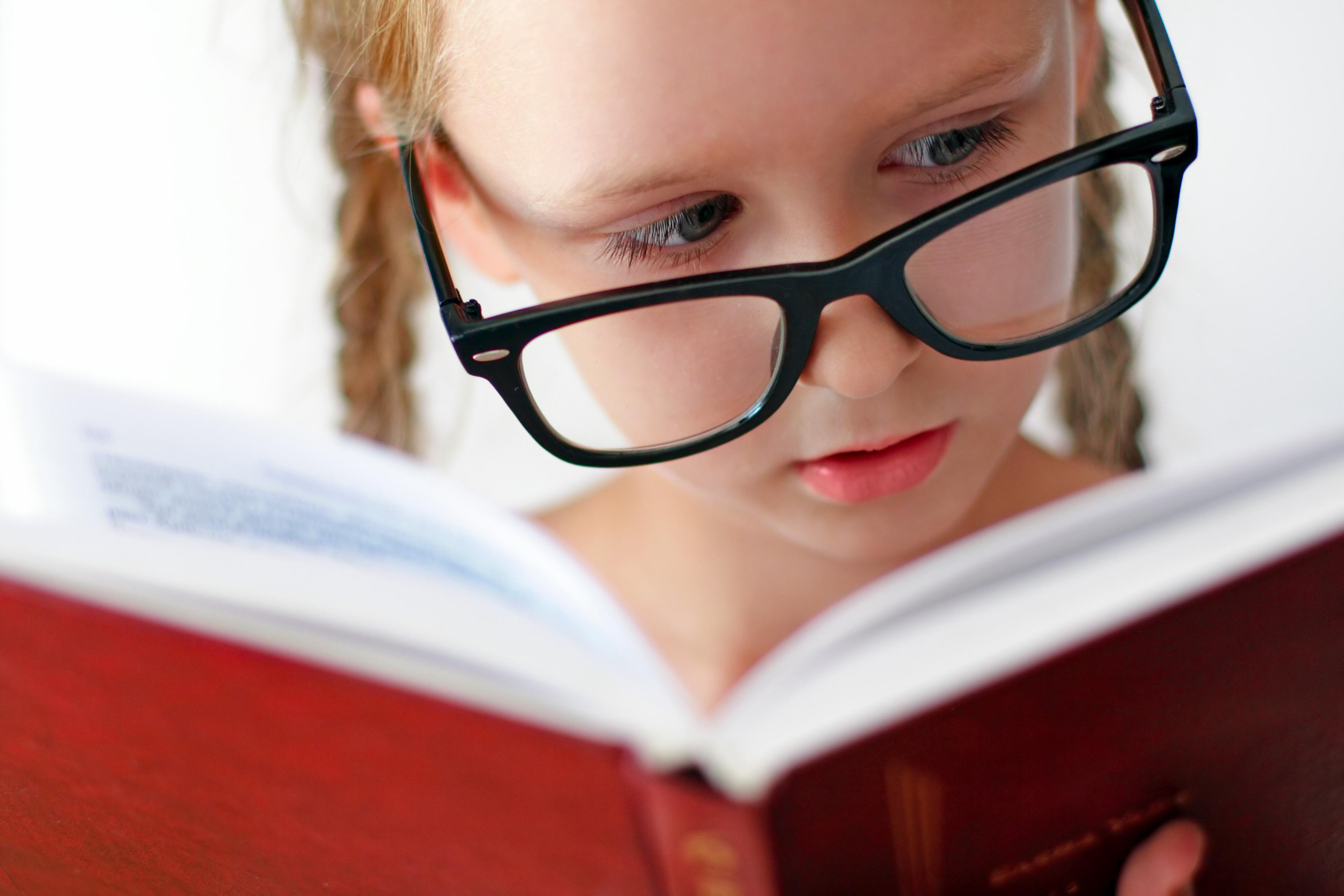 Girl wGlasses Reading_69332863